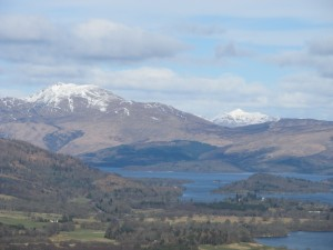 A snow-capped Ben Lomond looks over the loch