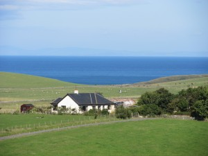 Rolling pastures framed by the deep blue sea in the background: Galloway in miniature