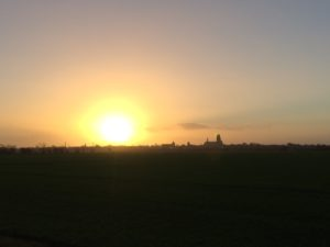 Sunrise on Christmas morning with Ribe Cathedral visible across the flat Jutland heathlands